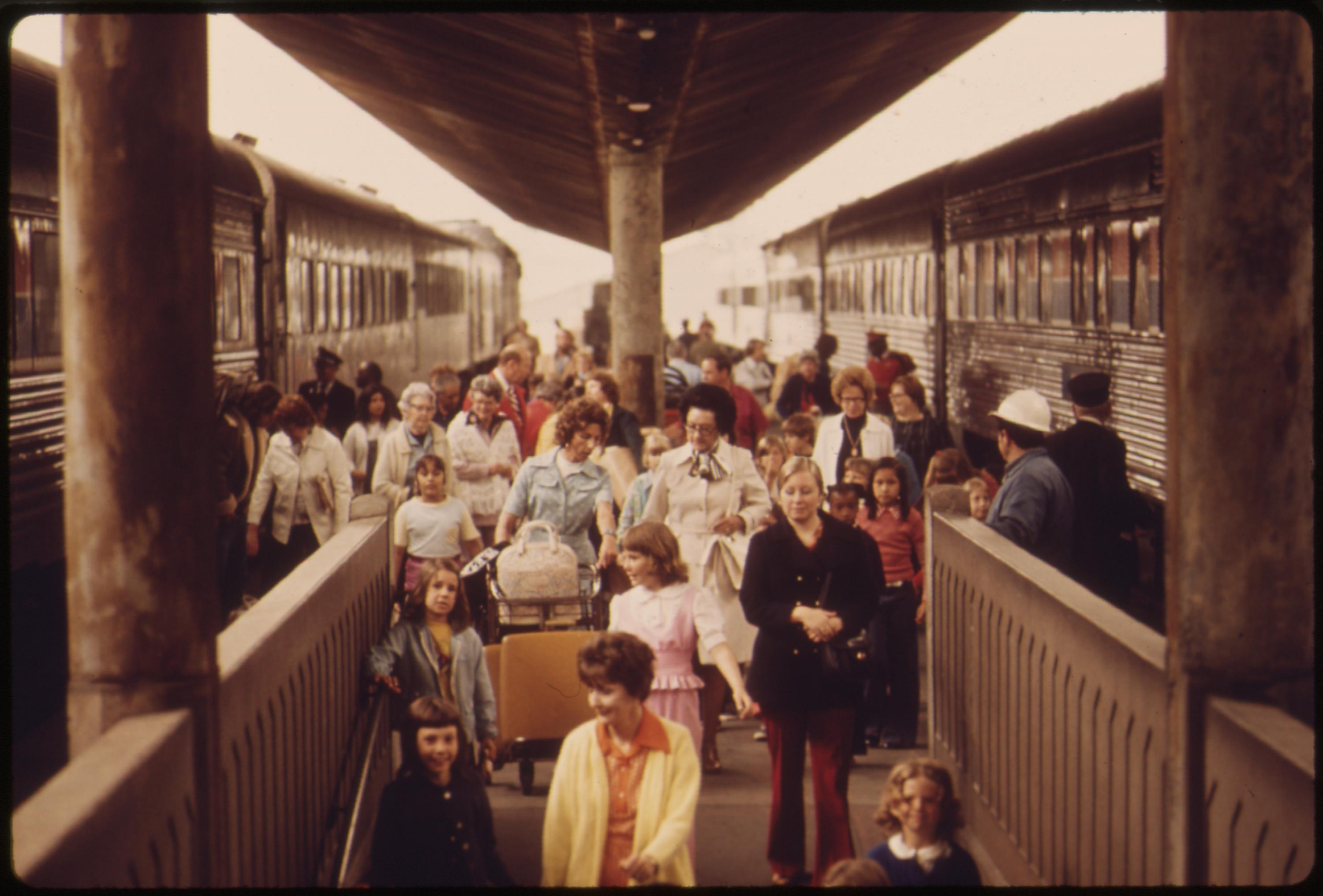 Passengers who have just arrived head into the Los Angeles Union Passenger Terminal after riding on Amtrak trains, May 1974