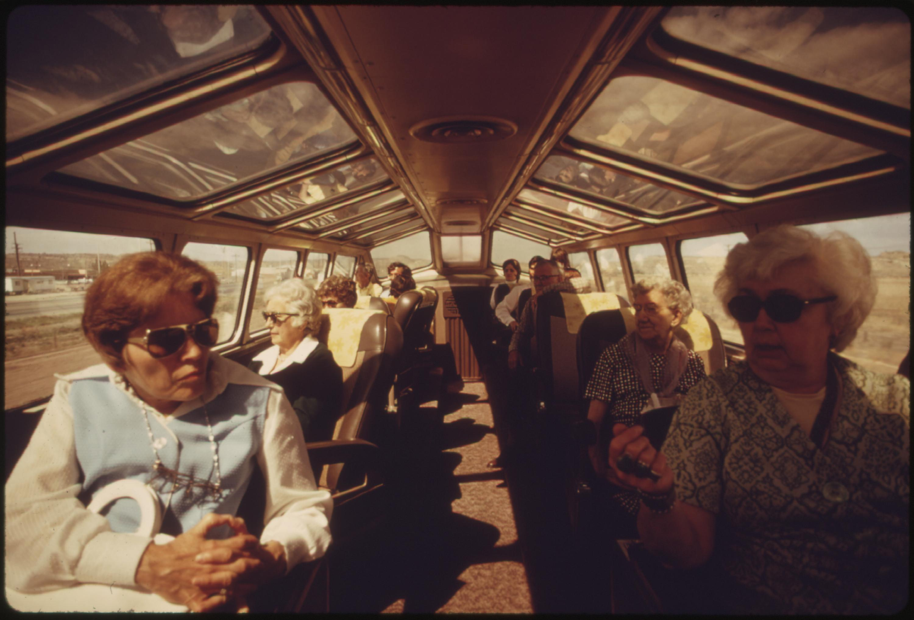 The dome car on Amtrak trains is a popular place for passengers who want to watch the scenery unfold, June 1974