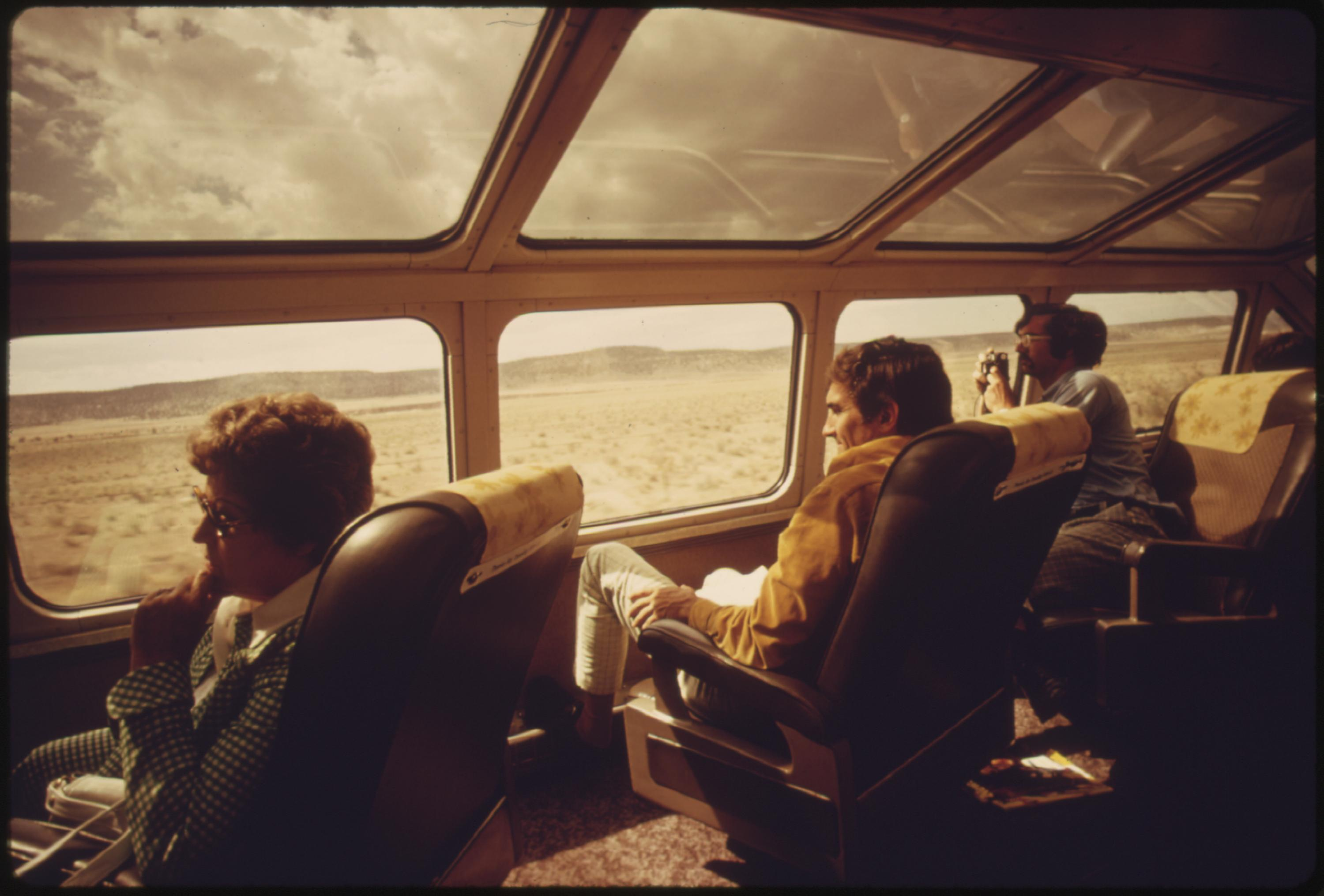 The dome car on Amtrak trains is a popular place for passengers who want to watch the scenery unfold or take pictures of it to show the folks back home, June 1974