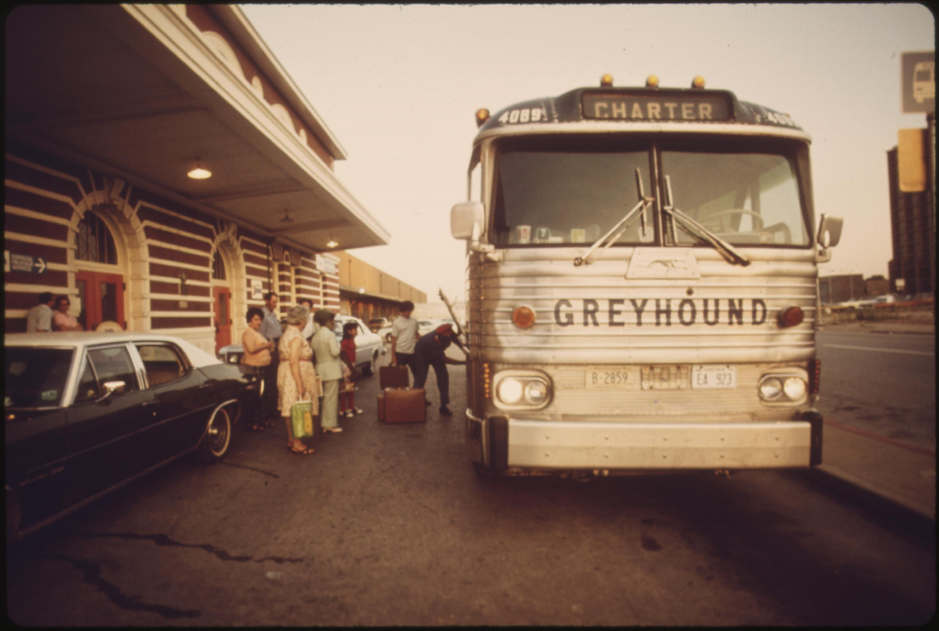 Train passengers bound for St. Louis, Missouri, board a chartered bus in Fort Worth, Texas, June 1974