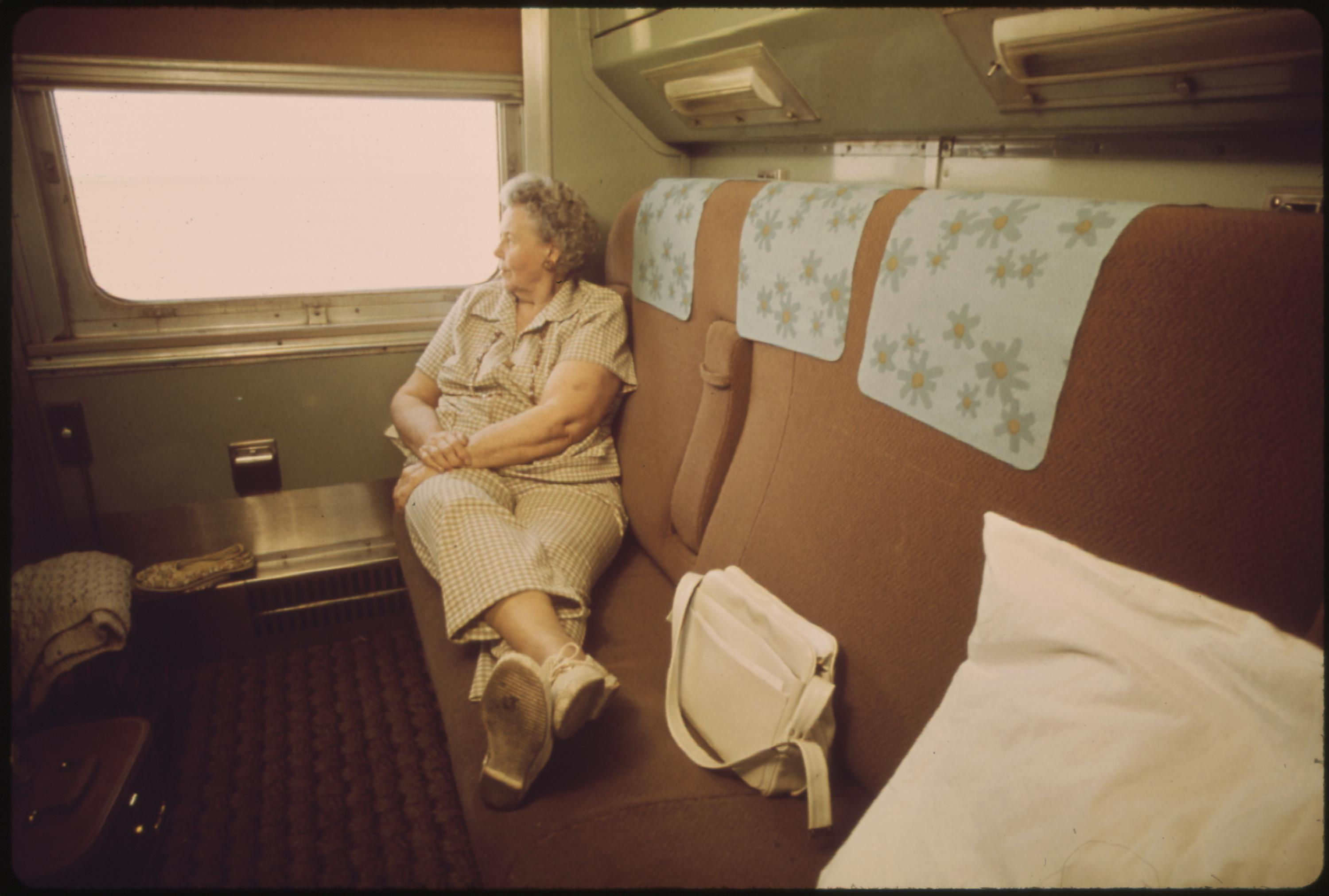 Traveler relaxes in the privacy of her compartment on the Empire Builder passenger train enroute from Chicago to East Glacier Park, Montana, and Seattle, Washington, June 1974