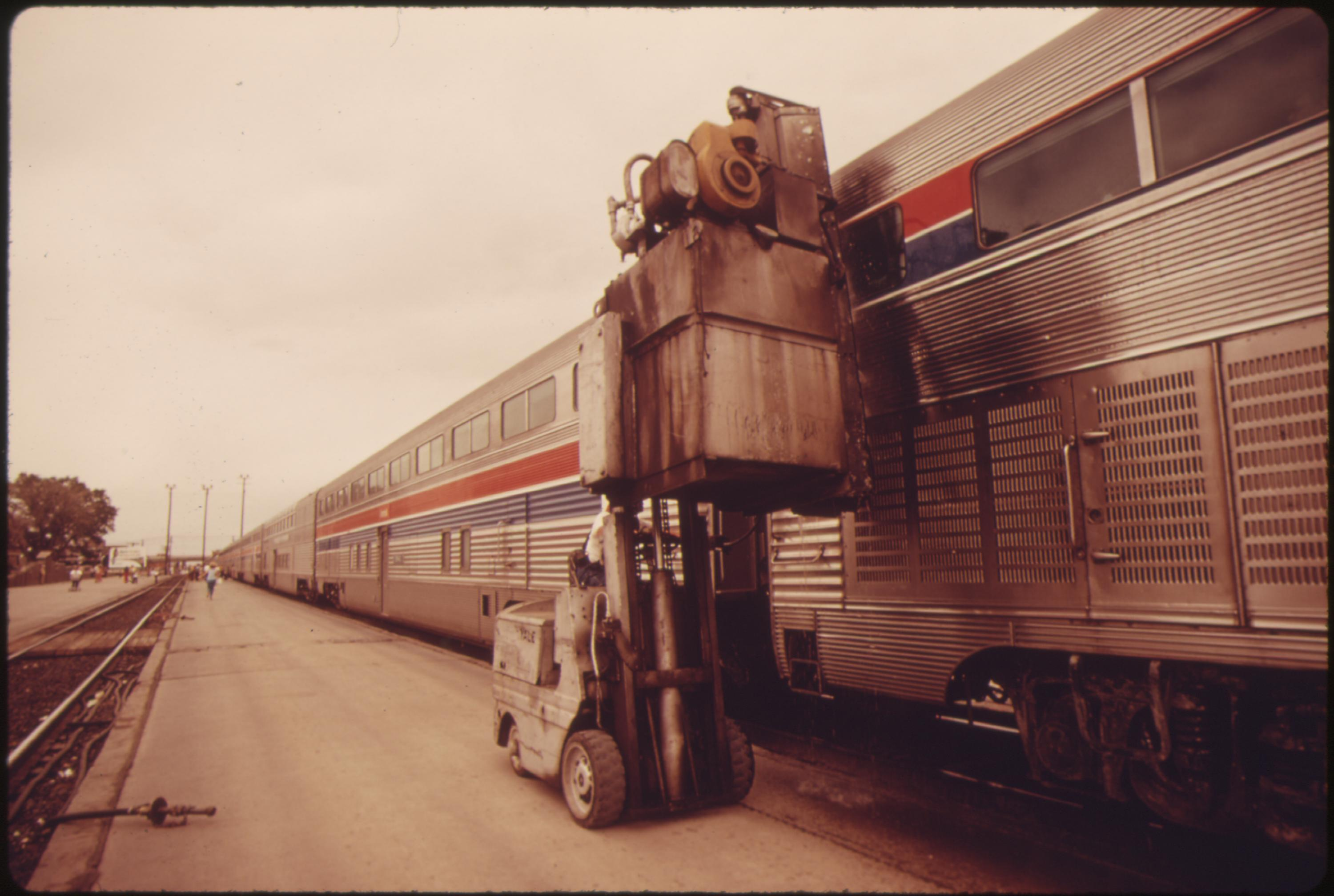 Window washing equipment is used on Amtrak's Southwest Limited during a stop at Albuquerque, New Mexico, June 1974