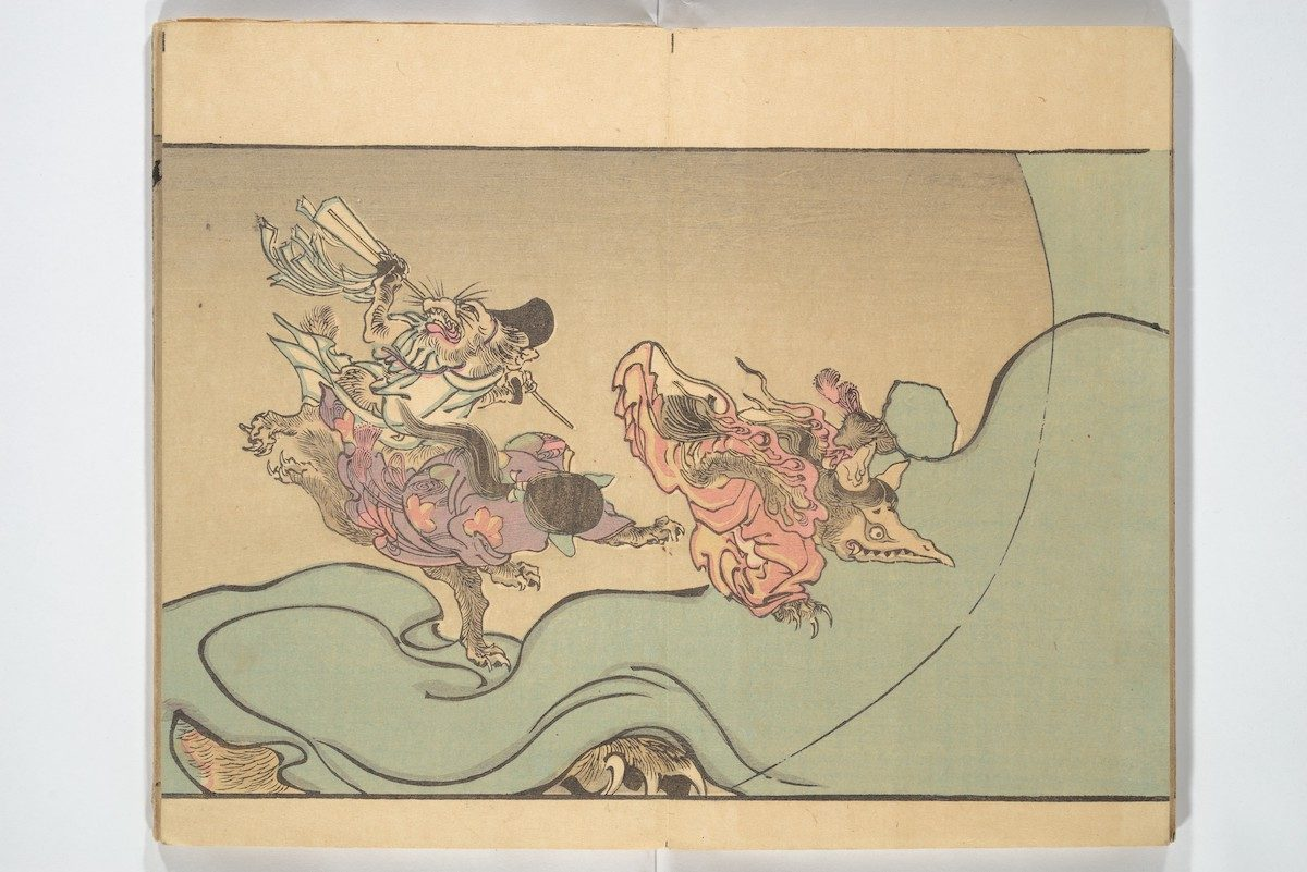 Animal demons, including one resembling a mad Shinto priest, carouse on an enormous bolt of cloth. A clawed monster hides underneath.
