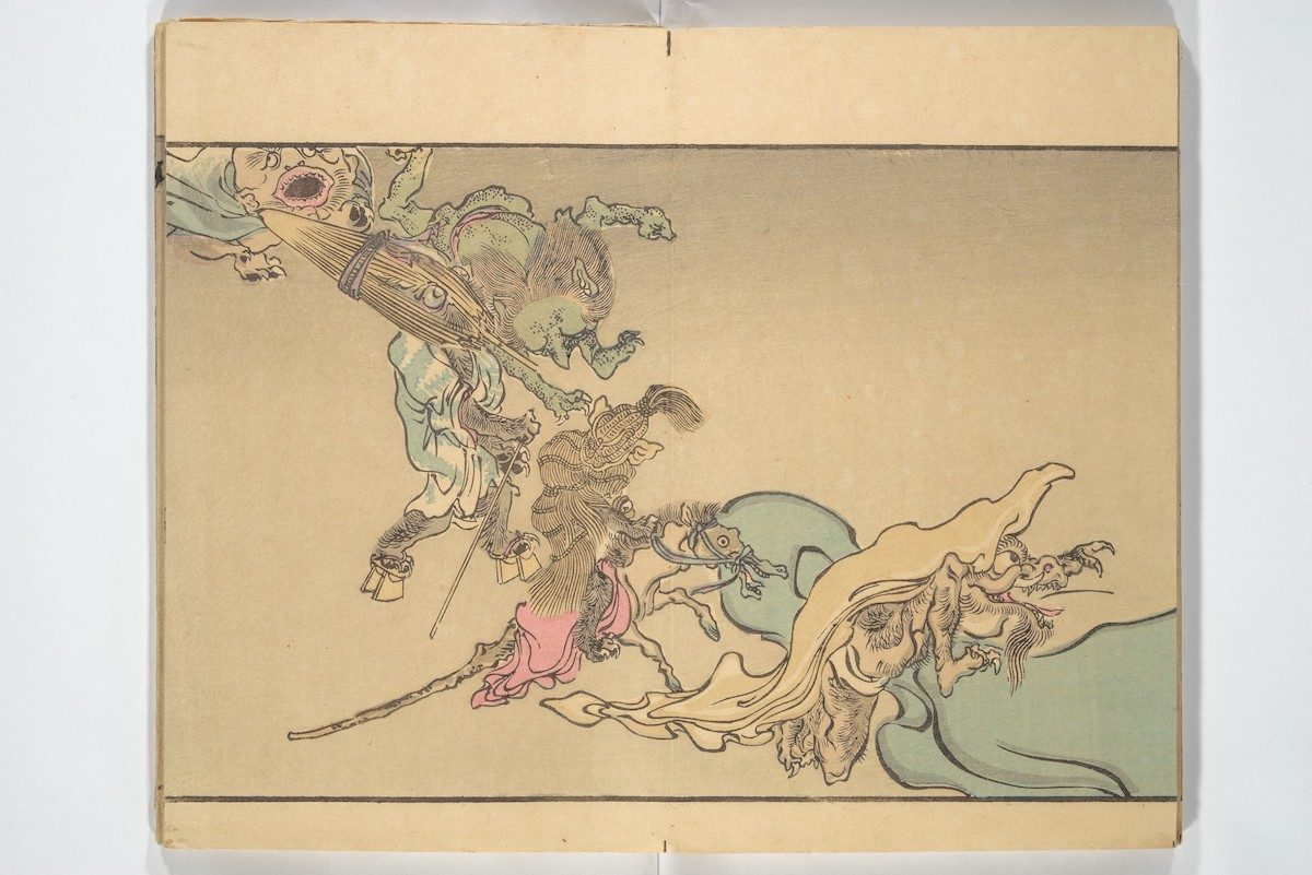 At left, a beaked demon holds an umbrella monster, followed by a rope monster riding a hobbyhorse, and a hairy monster with a long, horned snout (kirin).