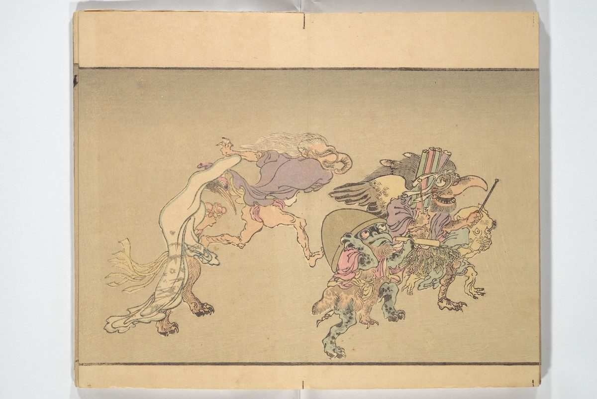 Several monsters, continue the procession, including one with a Buddhist monk's alms bowl on its head.