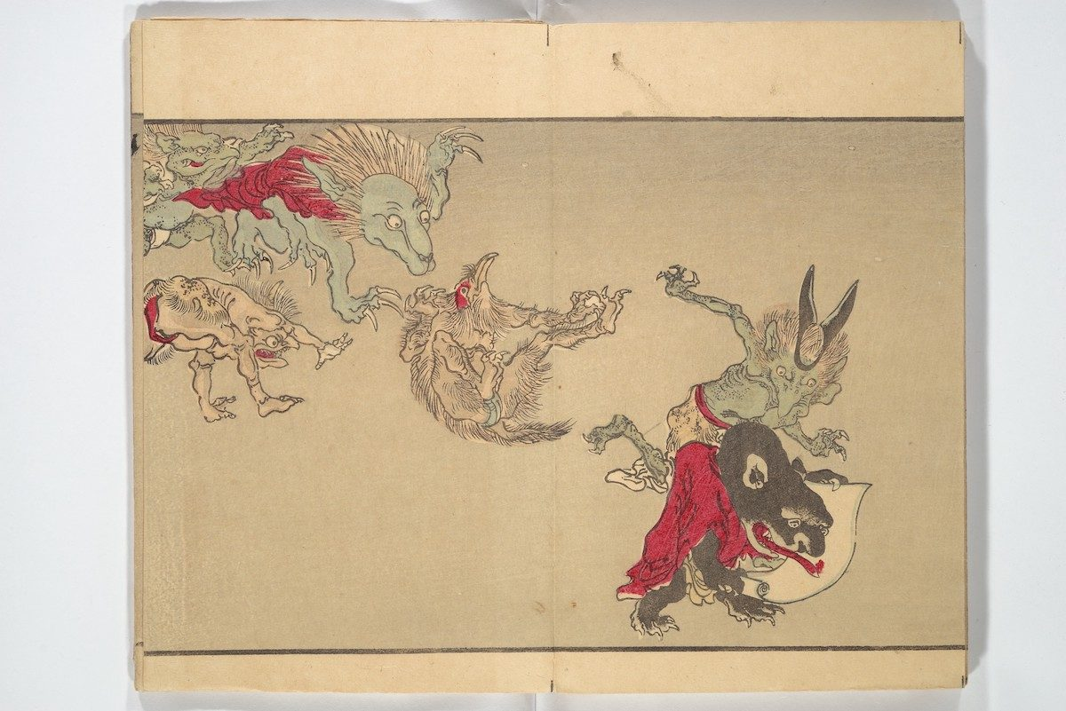 A group of rowdy ghouls appears, including, at far right, a demon in a red robe with a hand scroll.