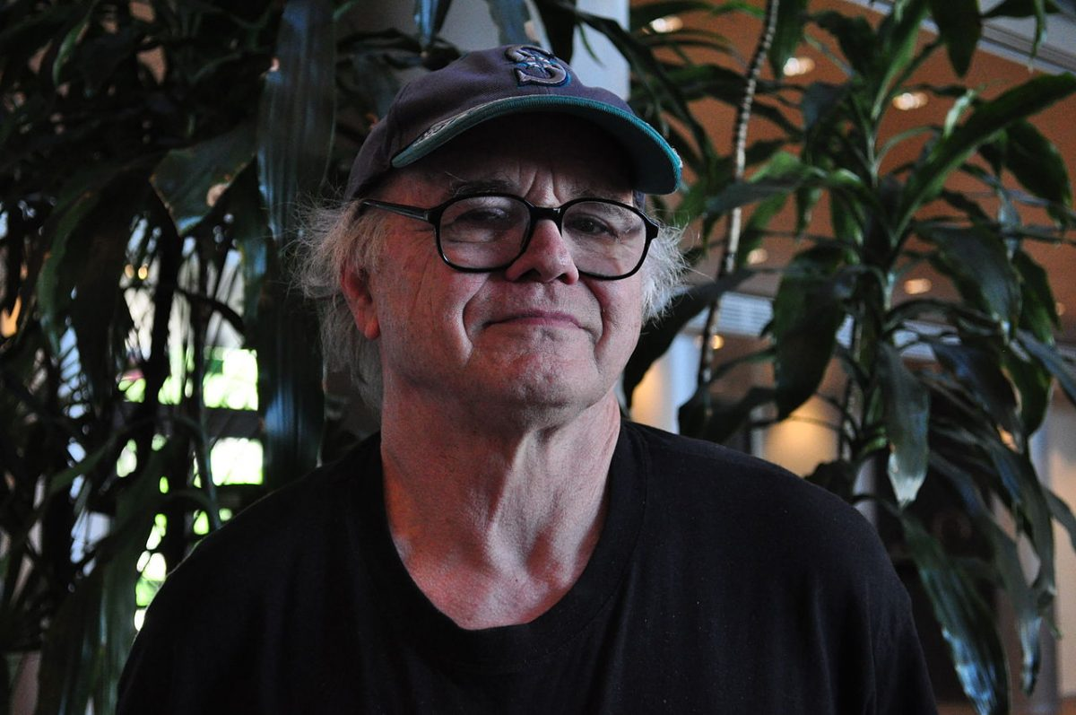 Seattle artist Gregory Blackstock, photographed in the lobby of City Hall, Seattle, Washington where a picture of his was part of an exhibition of art for Bumbershoot posters. Date 8 July 2010